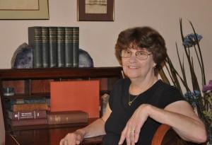 Joan at desk